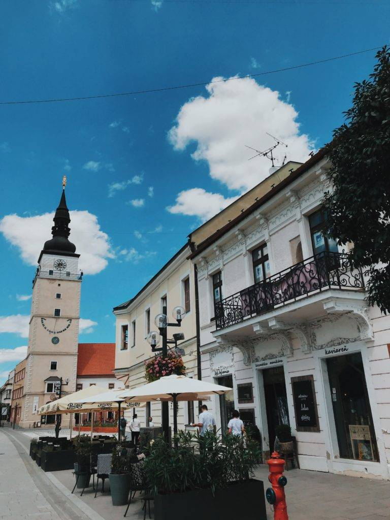 a cafe with Trnava bell tower in background