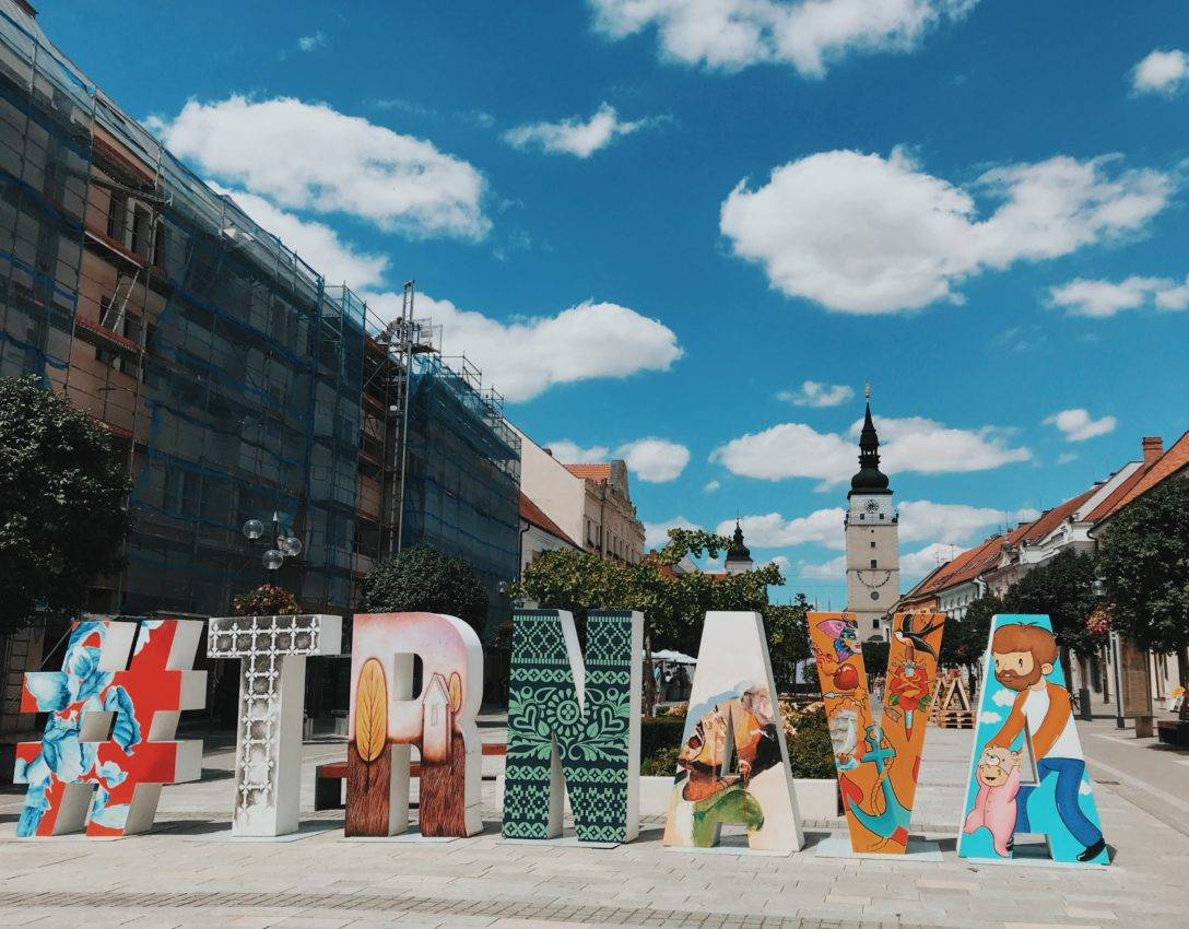 "letter blocks on the street, making up the word ""Trnava"""